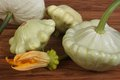 Ripe pattypan squash vegetables on a wooden brown table Stock Image