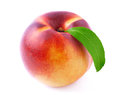 Ripe peach with leaf. Royalty Free Stock Photo