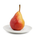Ripe pear and saucer Stock Images