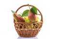 Ripe pears in a basket on white background Royalty Free Stock Image