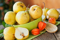 Ripe pears in green bowl close up Royalty Free Stock Photography
