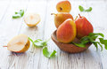 Ripe pears in wood bowl Royalty Free Stock Photo