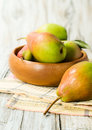 Ripe pears in a wooden bowl close up Stock Photos