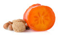 Ripe persimmons and nuts Royalty Free Stock Photography