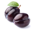 Ripe plums with leaf Royalty Free Stock Photo