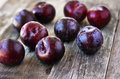 Ripe Plums on the wood backgraund. Royalty Free Stock Photo