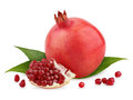 Ripe pomegranate fruit with leaves and seeds Royalty Free Stock Photos