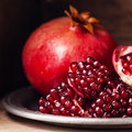 Ripe pomegranate pieces and grains of Royalty Free Stock Photos
