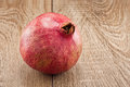 Ripe pomegranate on wooden table Stock Images
