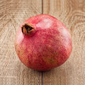 Ripe pomegranate on wooden table Royalty Free Stock Image
