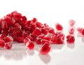 Ripe pomegraRipe pomegranate seeds on white Royalty Free Stock Photography