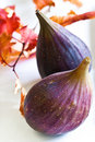Ripe purple figs on a white plate Stock Photography