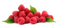 Ripe raspberries with green leaf isolated on white background macro Royalty Free Stock Photo