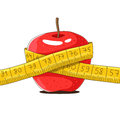 Ripe red apple and yellow measuring tape Royalty Free Stock Photo