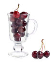 Ripe red cherries in glass cap against a white background Royalty Free Stock Image