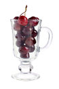 Ripe red cherries in glass cap against a white background Stock Photography