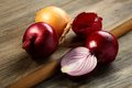 Ripe red and gold onions. Stock Photos