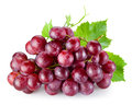 Ripe red grape with leaves isolated on white Royalty Free Stock Photo