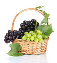 Ripe red grapes in basket Stock Images