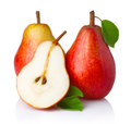 Ripe red pear fruits with green leaves on white background Royalty Free Stock Photo