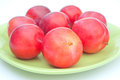 Ripe red plums on plate Royalty Free Stock Images