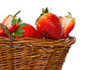 Ripe red strawberries in a basket on a white background Stock Image