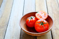 Ripe red tomatoes in a bowl food closeup Royalty Free Stock Photos