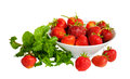 Ripe strawberries in  bowl and mint leaves isolated Royalty Free Stock Photo