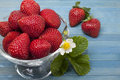 Ripe strawberries in a vase on a blue background Royalty Free Stock Photography