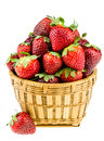 Ripe strawberries in a wicker basket isolated on a white backgro piled high against background Royalty Free Stock Photography