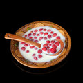 Ripe strawberry with milk in a bowl Royalty Free Stock Photo