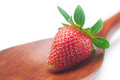 Ripe strawberry on a wooden spoon Royalty Free Stock Photo