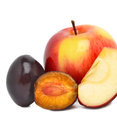 Ripe sweet plum and red apples Royalty Free Stock Photo