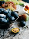 Ripe sweet plums in bowl Royalty Free Stock Photo