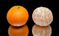 Ripe tangerines on a black background with reflection Stock Photo
