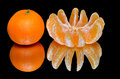 Ripe tangerines on a black background with reflection Stock Image