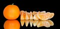 Ripe tangerines on a black background with reflection Royalty Free Stock Image