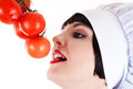 Ripe tomatoes chef reaches for Royalty Free Stock Image