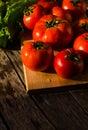 Ripe tomatoes on a cutting Board