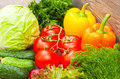 Ripe vegetables on a wooden background close up Stock Photo