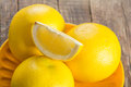 Ripe yellow grapefruit a on wood table Stock Photography