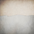 Riped old paper on grunge wall background Stock Photo