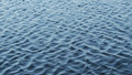 Ripples across the surface of a real water lake Royalty Free Stock Photo