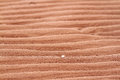 Ripples in red beach sand closeup Royalty Free Stock Photo