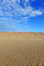 Ripples in sand dunes and blue sky skies Stock Photography