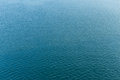 Rippling blue water surface background Royalty Free Stock Photo