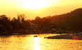 RISHIKESH, INDIA - sunset in Ganga river, boat rafting Royalty Free Stock Photo
