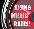 Rising interest rates words speedometer gauge increase loan fina on a or to illustrate higher costs for borrowing money in a Royalty Free Stock Photography