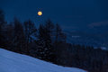 Rising moon at night in the italian alps Stock Photos