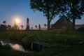 Rising moon over a foggy Latvian countryside at dusk Royalty Free Stock Photo